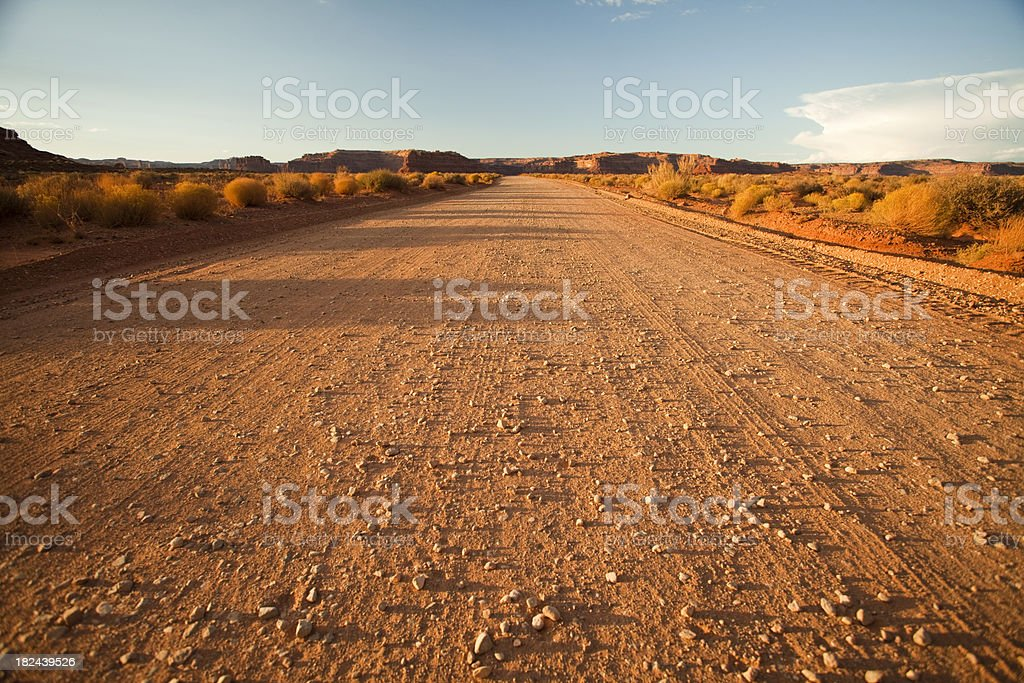 Lonely dirt road at noon stock photo