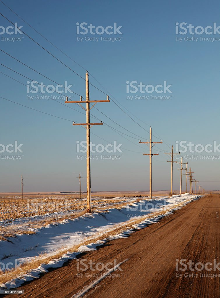 Lonely dirt road in winter royalty-free stock photo