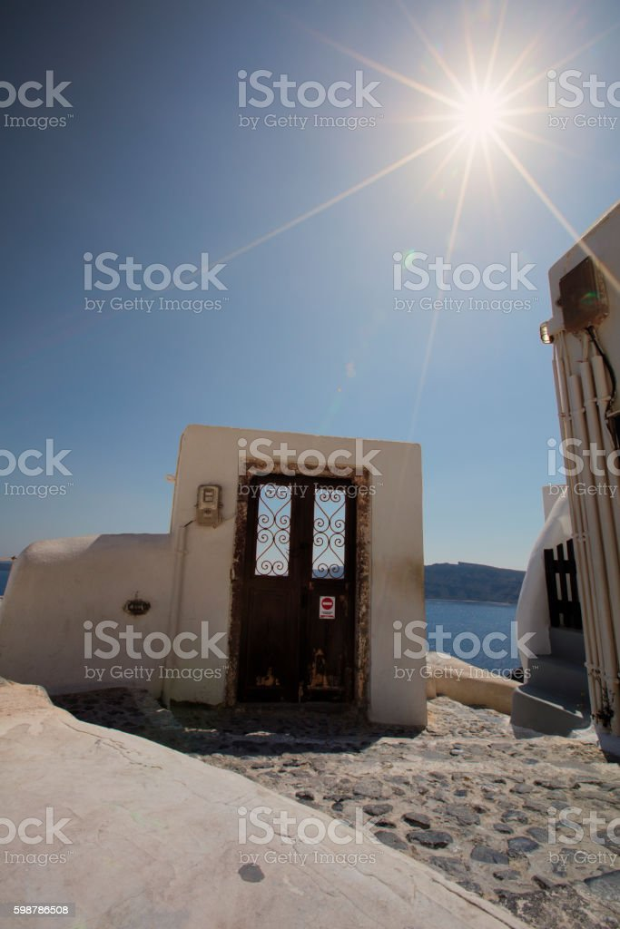 Lonely door in Santorini stock photo
