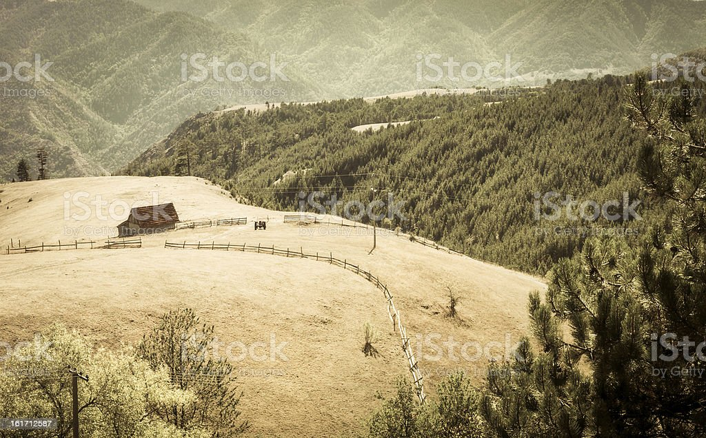 Lonely farmhouse in a valley royalty-free stock photo