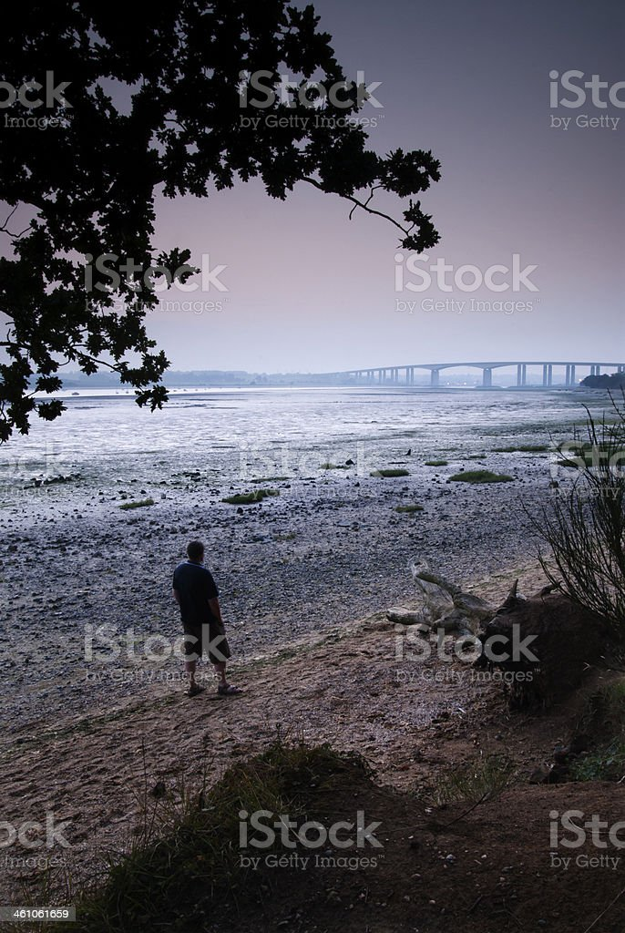 Lonely figure on the river bank royalty-free stock photo
