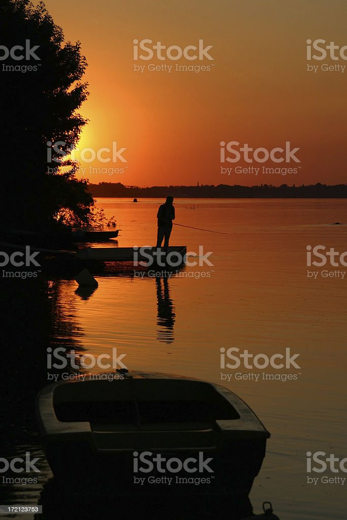 Lonely fisherman on the Danube river royalty-free stock photo