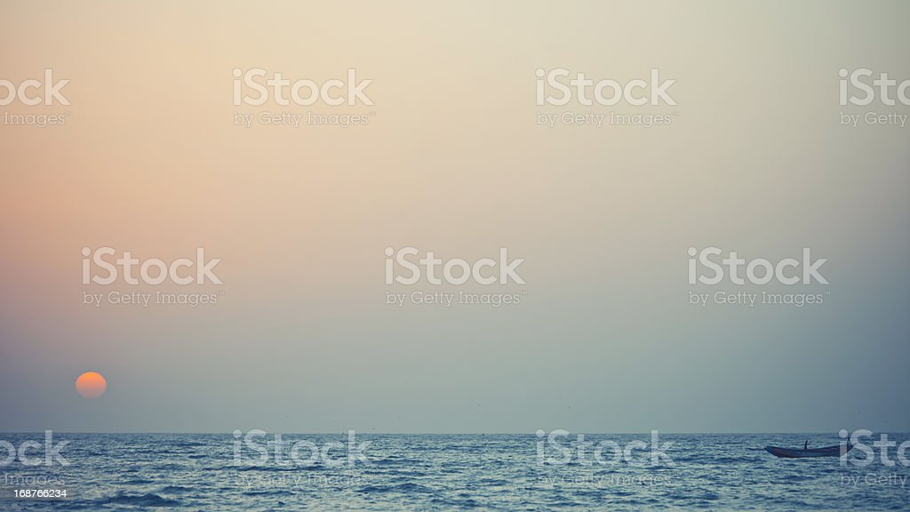 lonely fishing boat royalty-free stock photo
