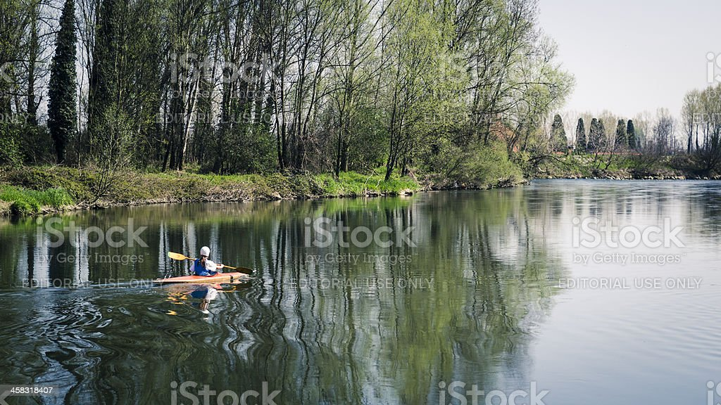 lonely girl canoeing on a river royalty-free stock photo