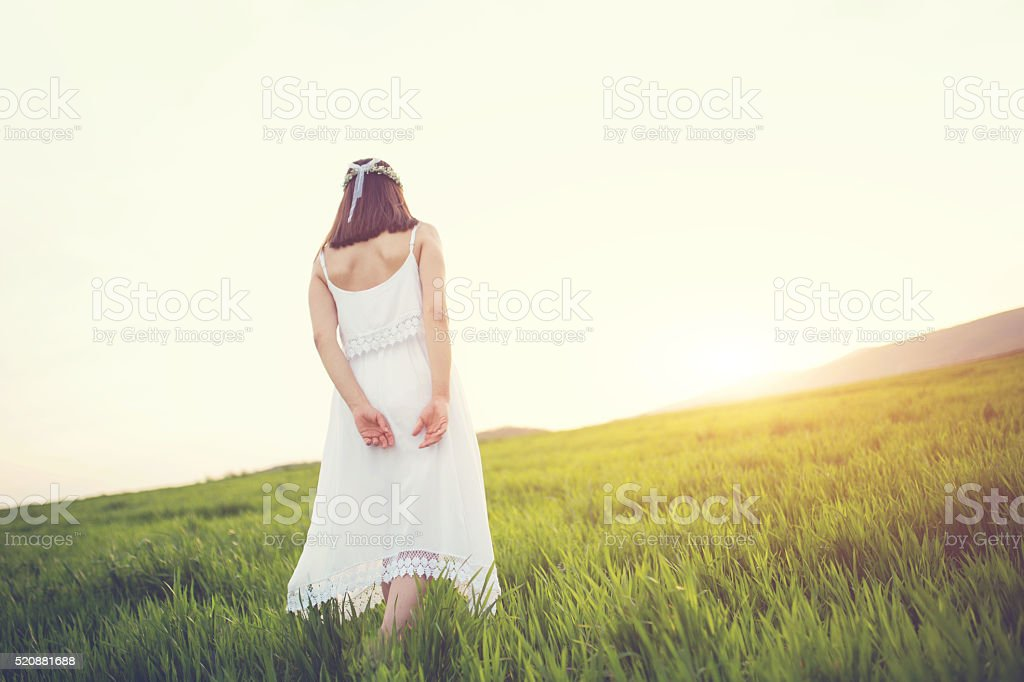 Lonely girl on a meadow stock photo