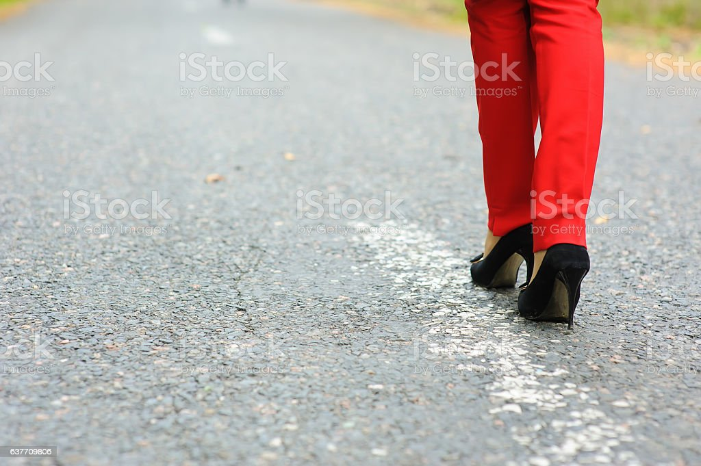 Lonely girl on the road stock photo
