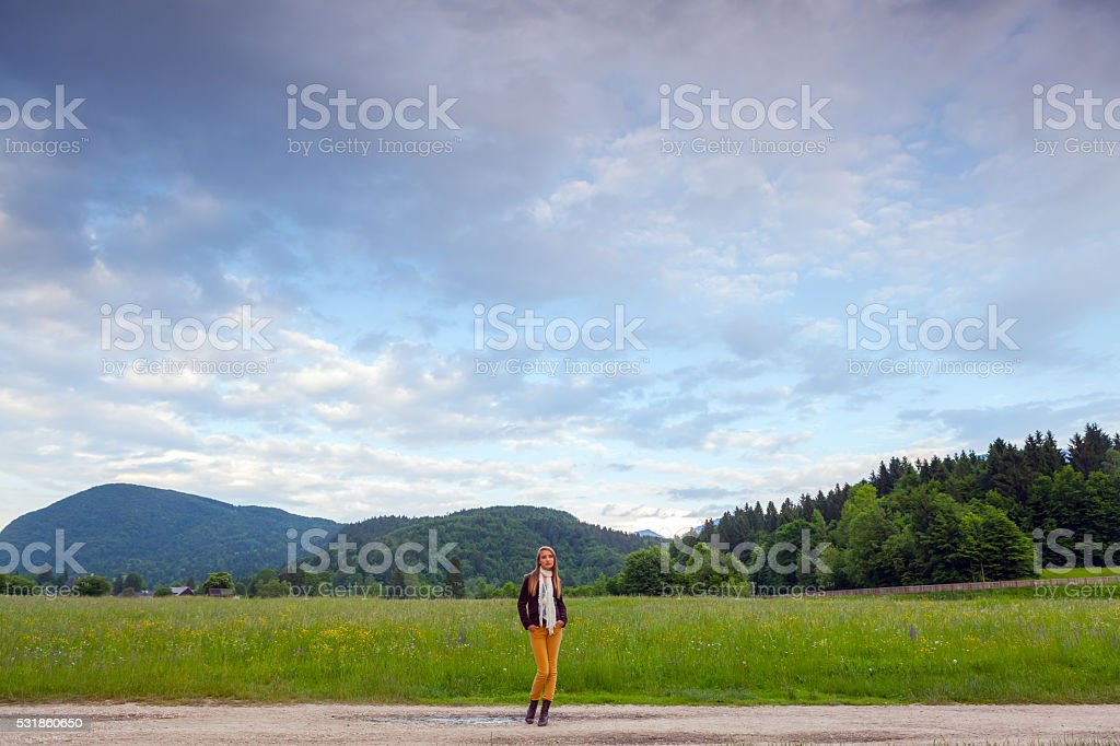lonely girl under a big sky stock photo