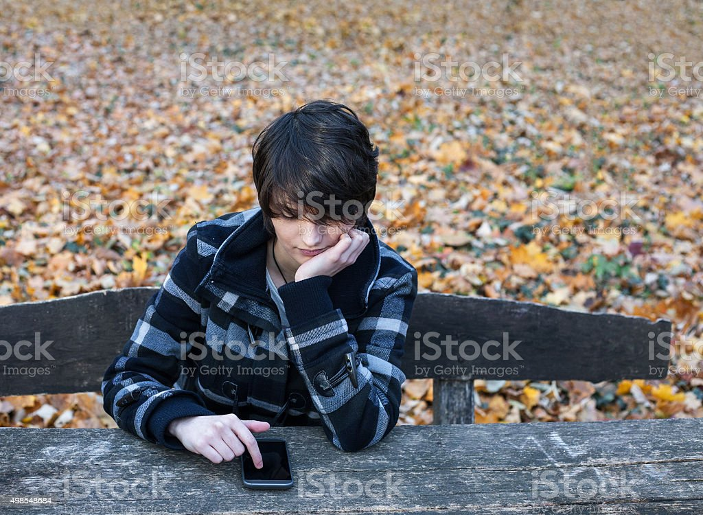 Lonely girl using telephone royalty-free stock photo