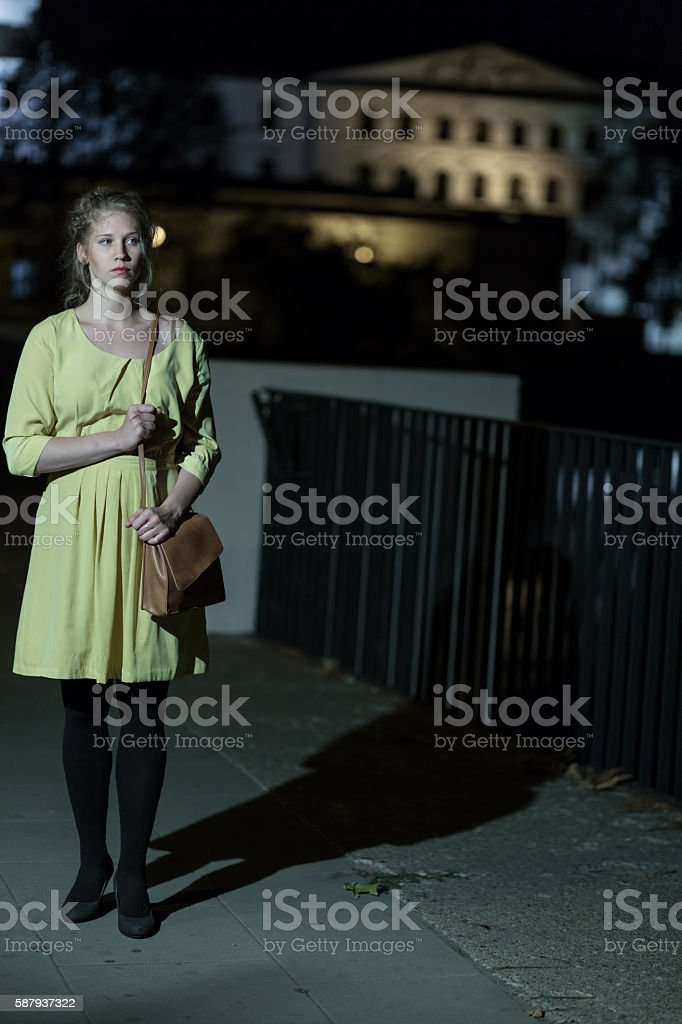 Lonely girl walking at night stock photo