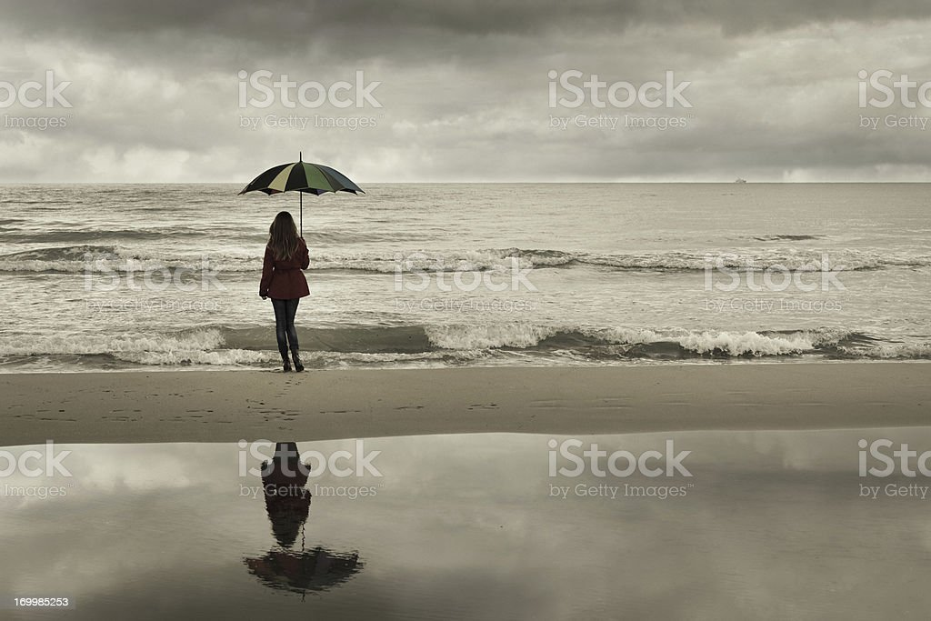 lonely girl with umbrella at the sea royalty-free stock photo
