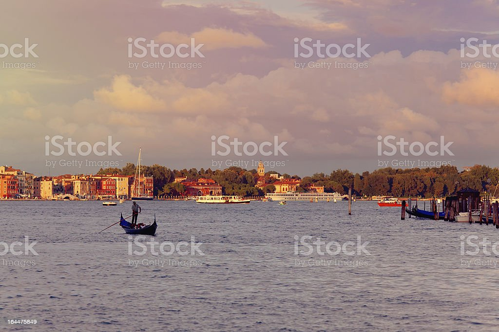 lonely gondola on the venetian lagoon royalty-free stock photo