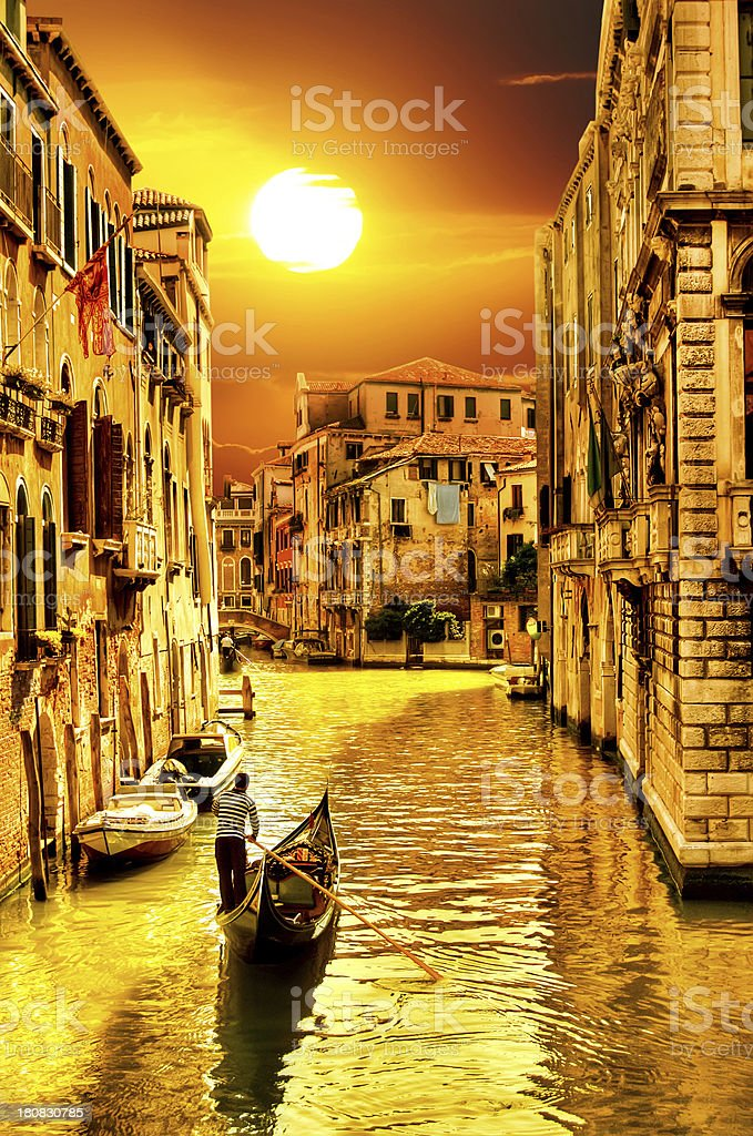 Lonely Gondolier at Sunset in Venice royalty-free stock photo