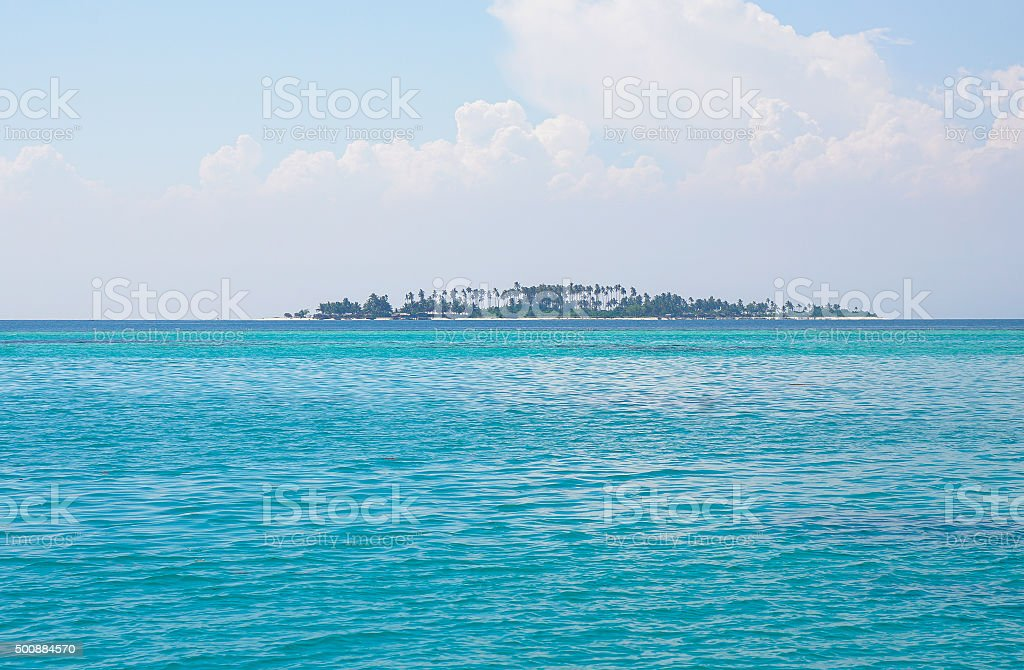Lonely Island in the deep blue caribbean sea stock photo