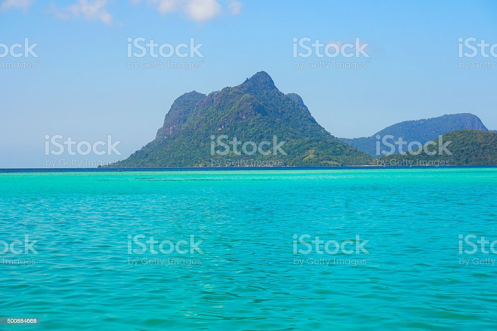 Lonely Island in the deep blue caribbean sea. stock photo