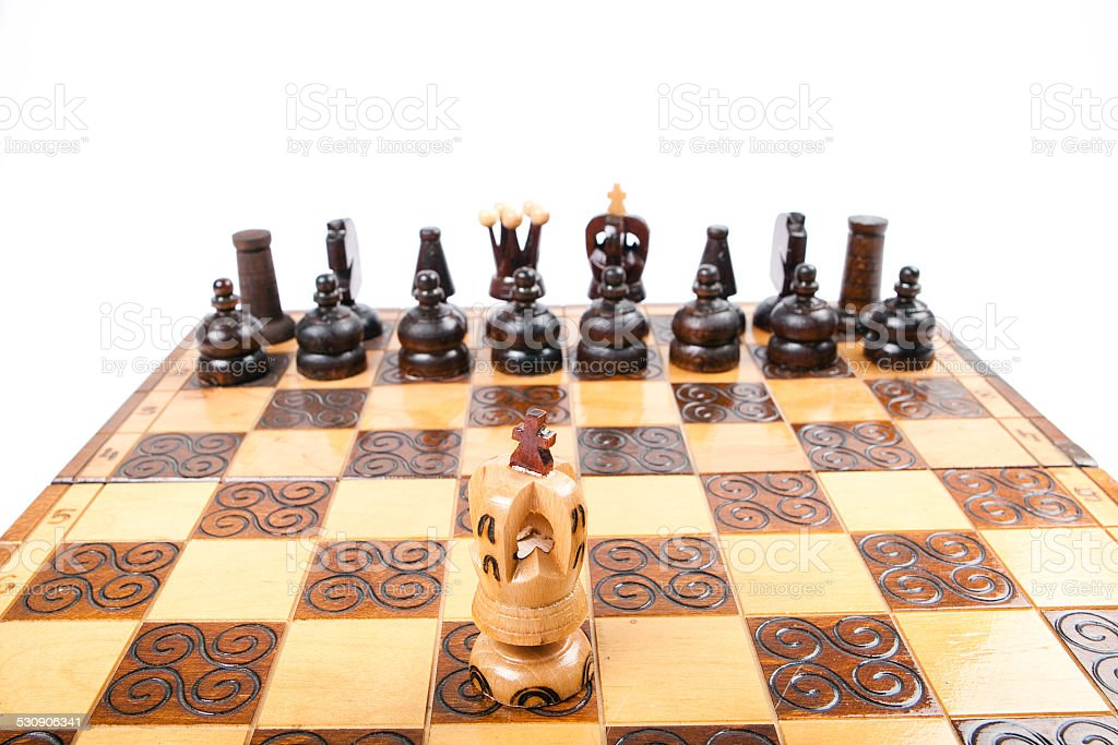 Lonely King fighting against enemies, Chess game, stock photo