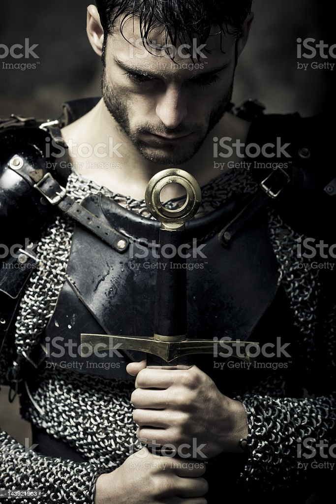 lonely knight in the darkness stock photo