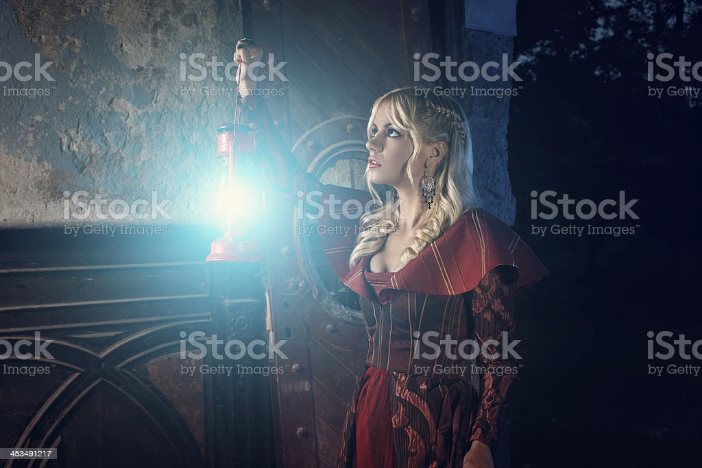 Lonely lady explores old castle royalty-free stock photo