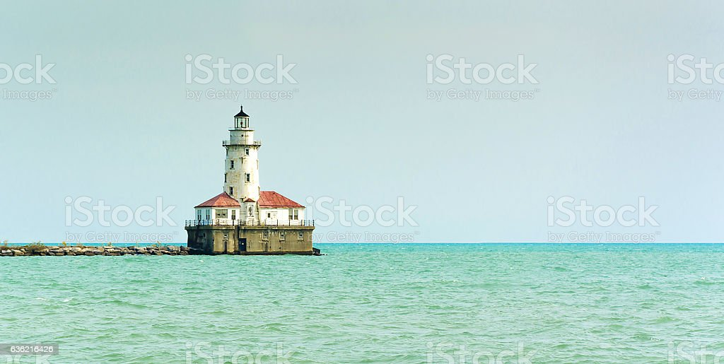 lonely Lighthouse in the sea stock photo