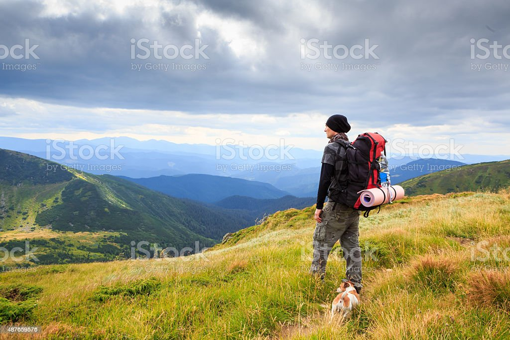 Lonely man in the mountains stock photo