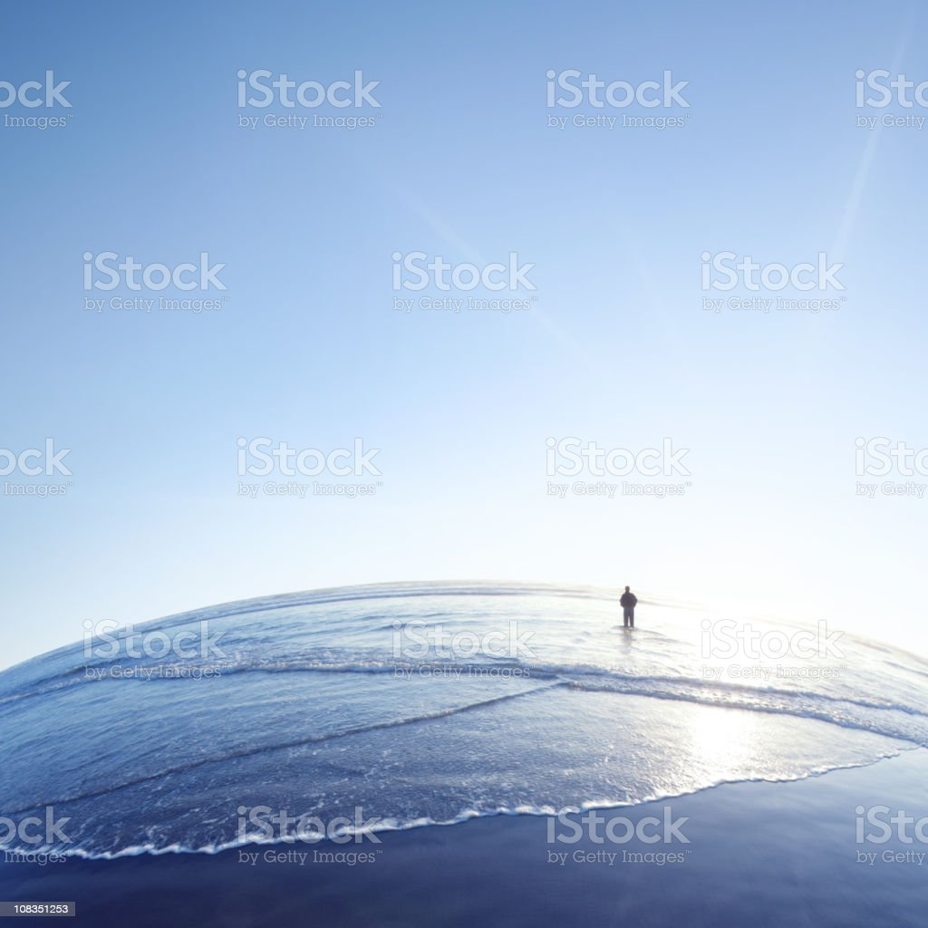XL lonely man on beach royalty-free stock photo