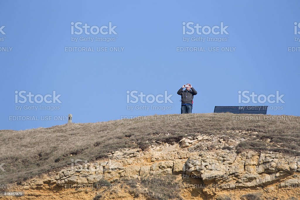 Lonely man taking a picture of the view stock photo
