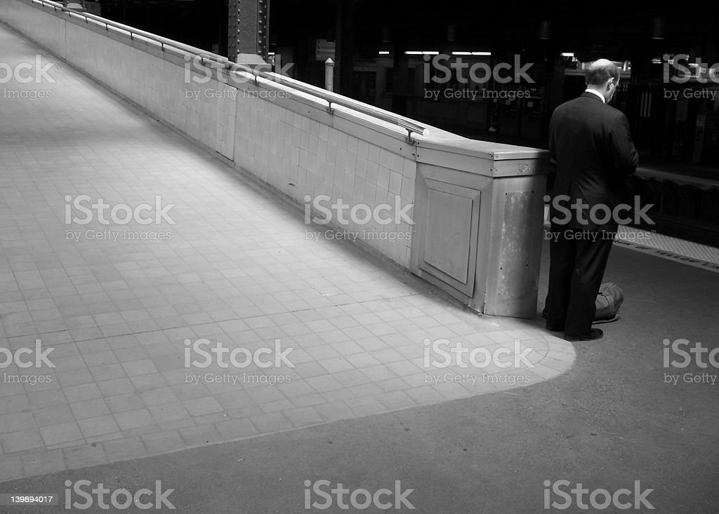 Lonely man waiting for a train royalty-free stock photo