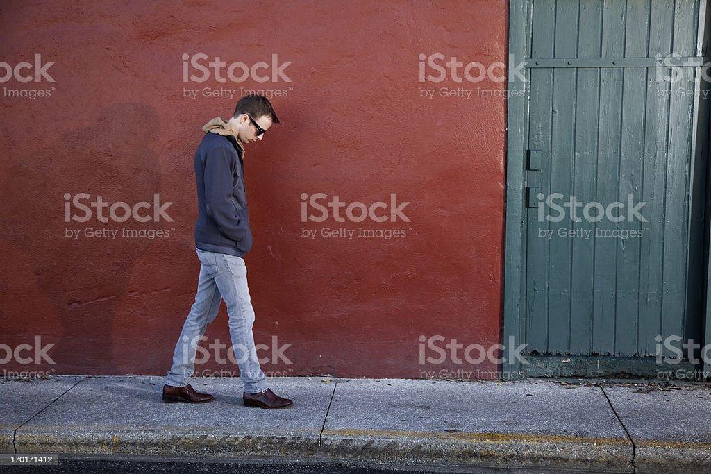Lonely man walking royalty-free stock photo