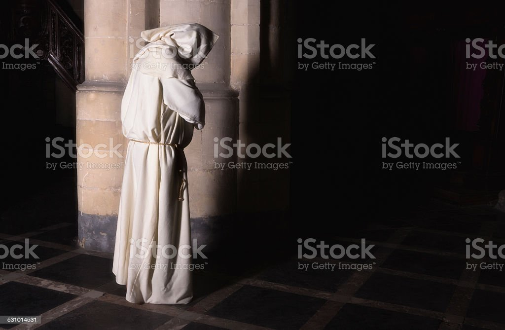 Lonely monk in darkness stock photo
