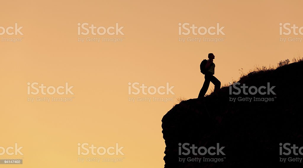 Lonely mountain climber at sunset. royalty-free stock photo