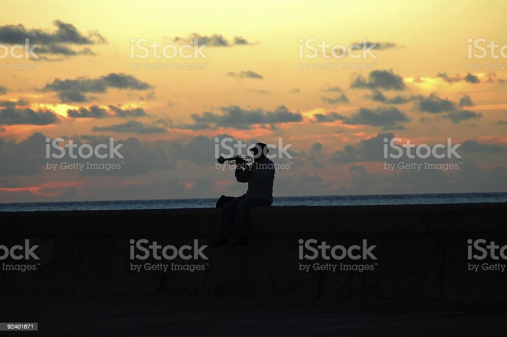 Lonely musician at sunset stock photo