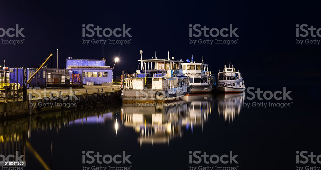 Lonely old ships on a city pier at night stock photo