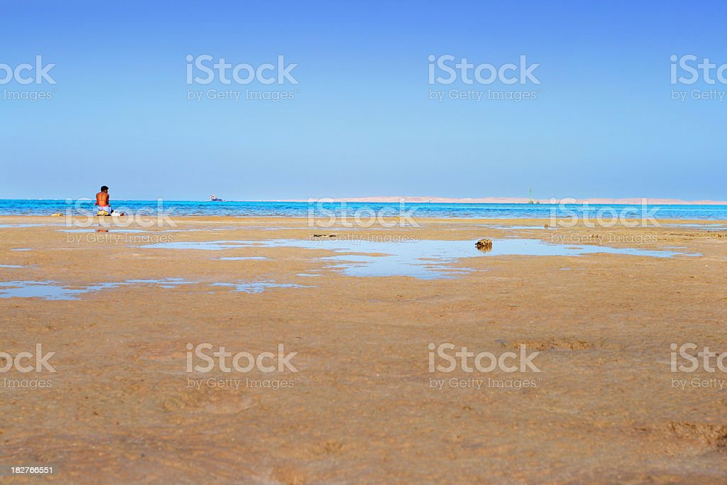 Lonely on beach stock photo