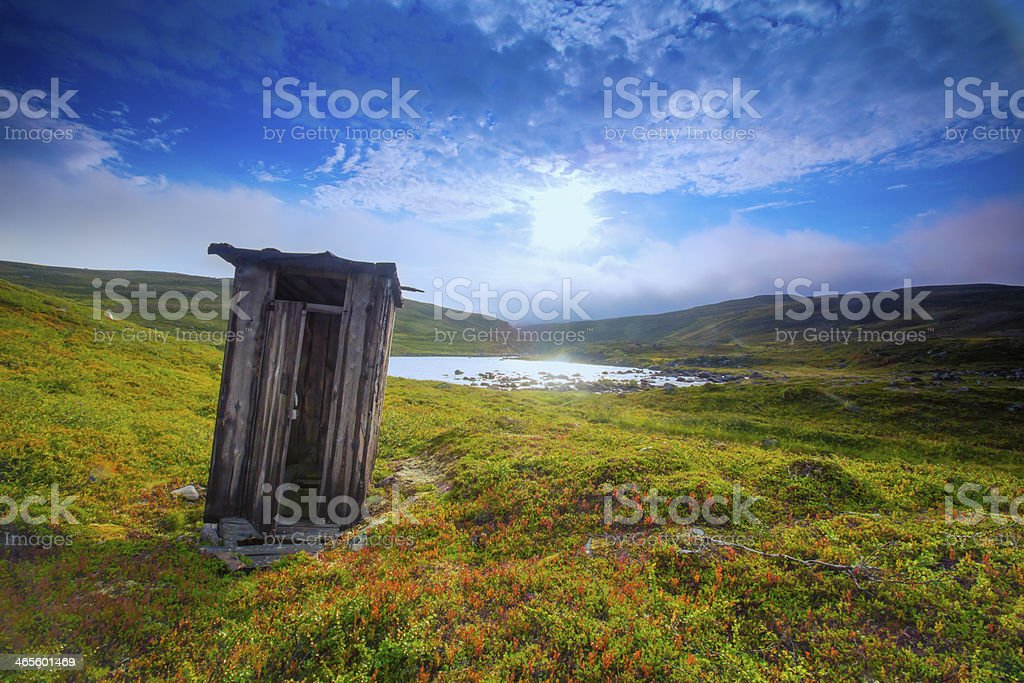 Lonely outhouse stock photo