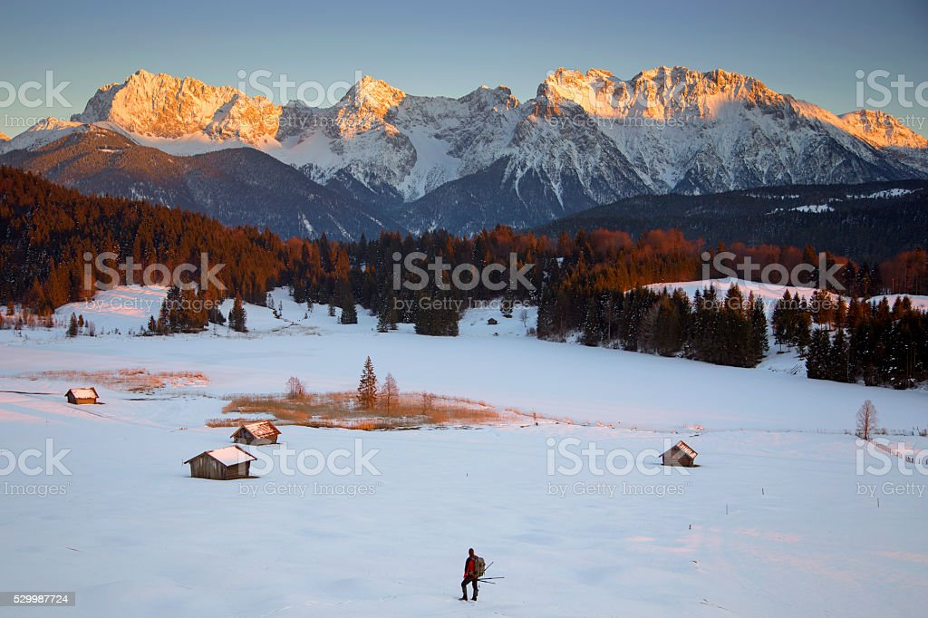 Lonely Photographer in wintertime at Lake Gerold stock photo