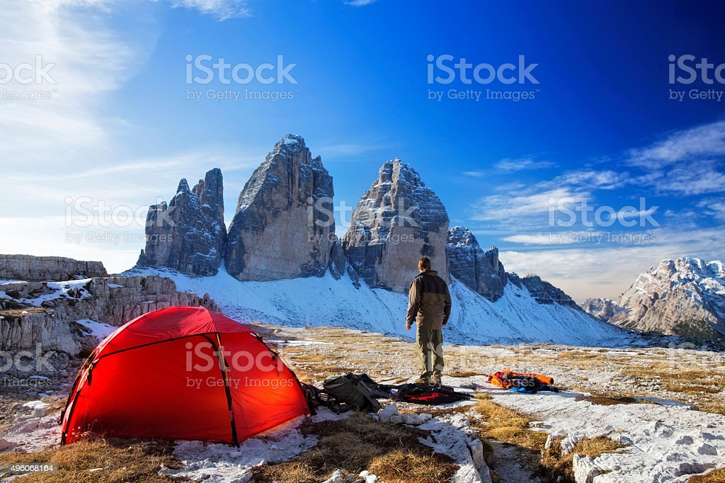 Lonely  Photographer with tent at the three Pinnacles in wintertime stock photo