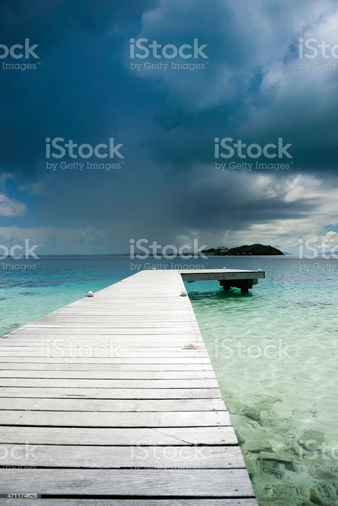 Lonely Pier towards Storm Clouds royalty-free stock photo