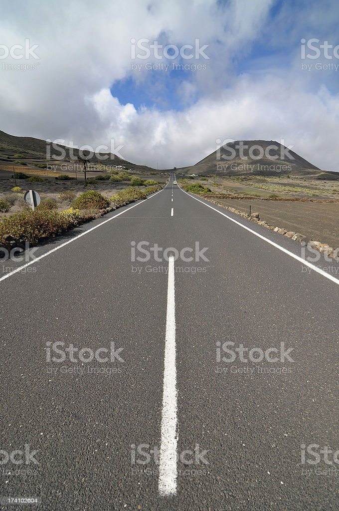 Lonely road in the deseret royalty-free stock photo