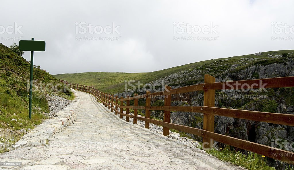 Lonely road or track in the mountains. stock photo