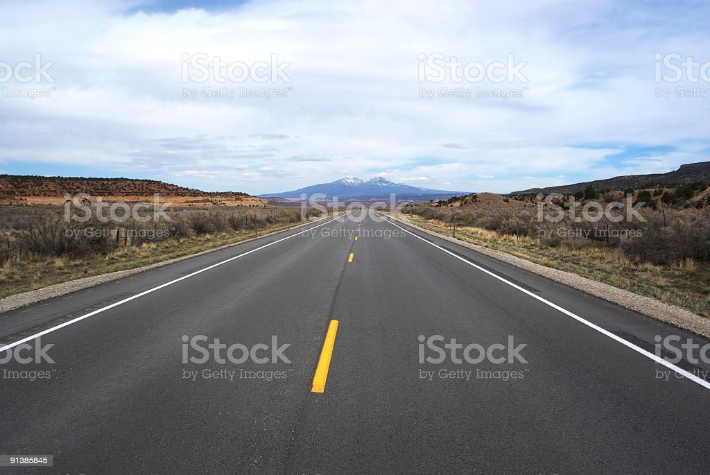 lonely road to the mountains stock photo