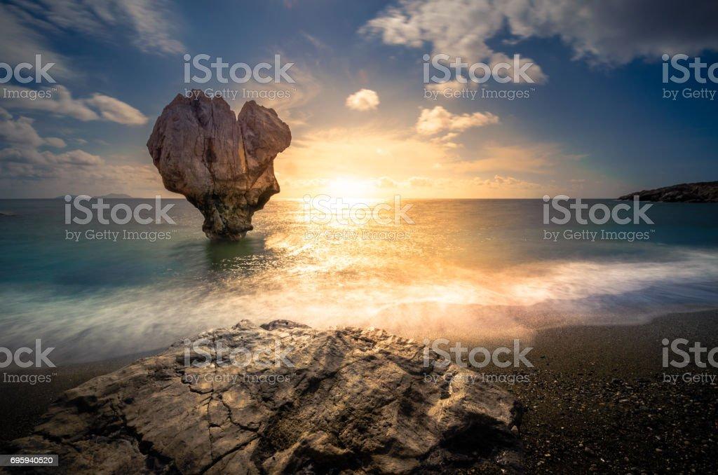 Lonely rock sculpture at the shape of heart, Preveli, Crete, Greece stock photo