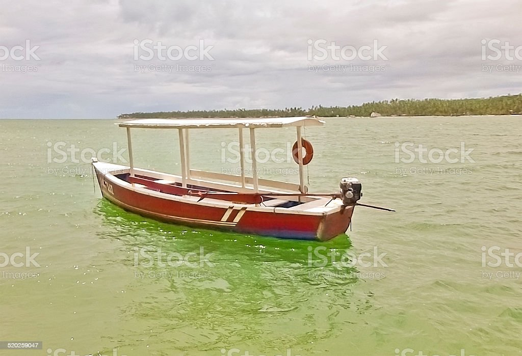 Lonely Rustic Boat in the Sea stock photo