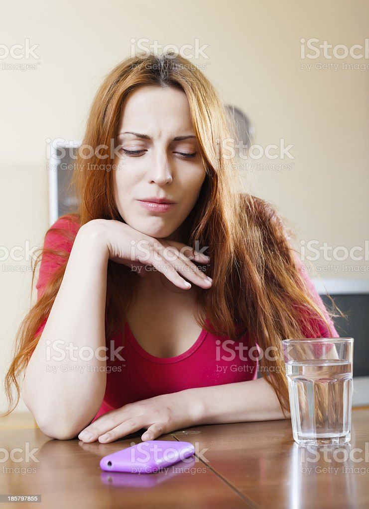 lonely sad girl at table in home royalty-free stock photo