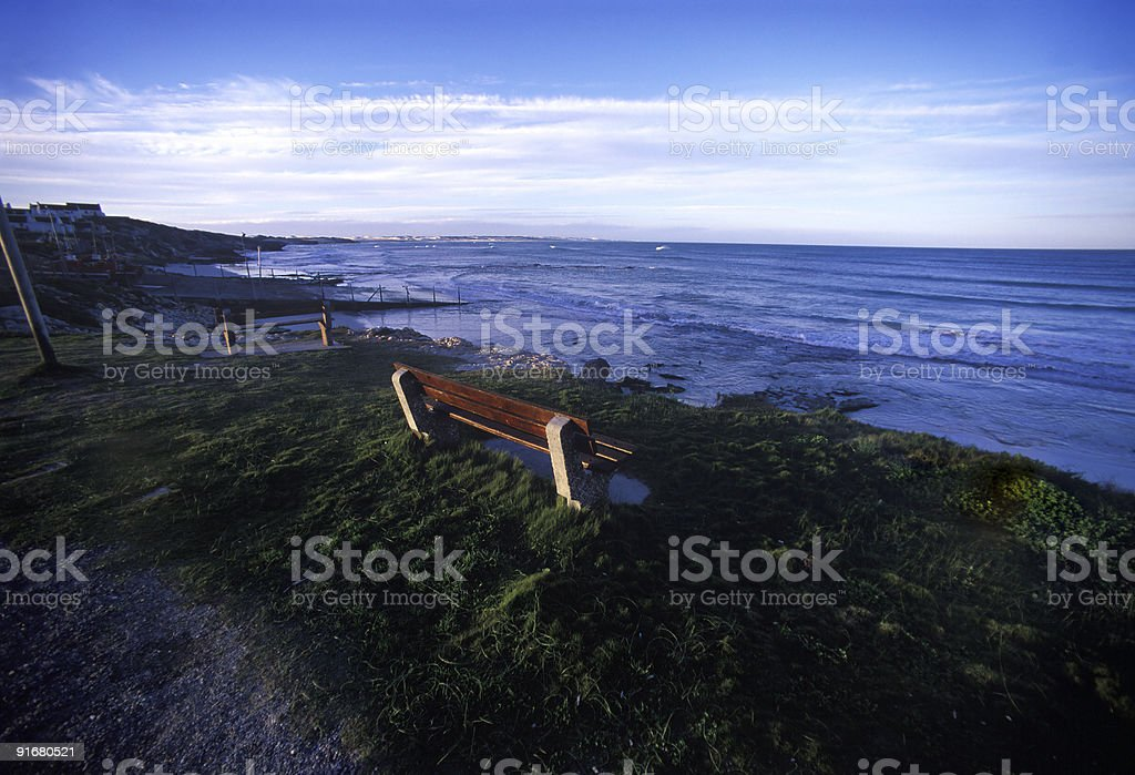 Lonely seaside bench stock photo