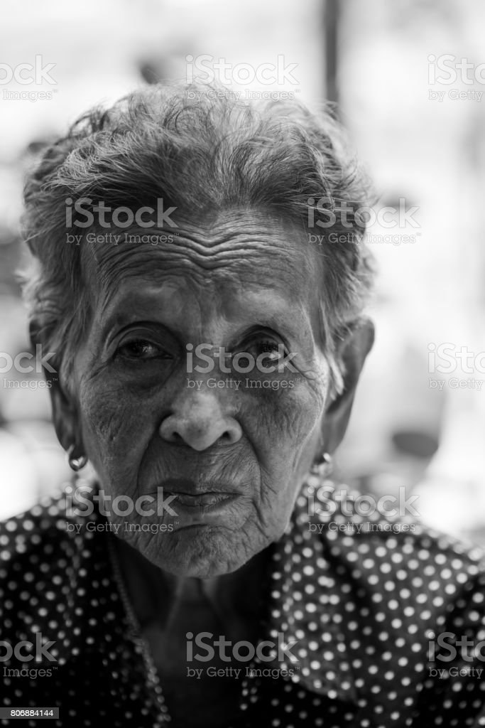 Lonely senior woman ,elderly,old woman,feelings,thoughtful, portrait sad depressed,wait, gloomy, worried, covering her face, Human face expressions stock photo