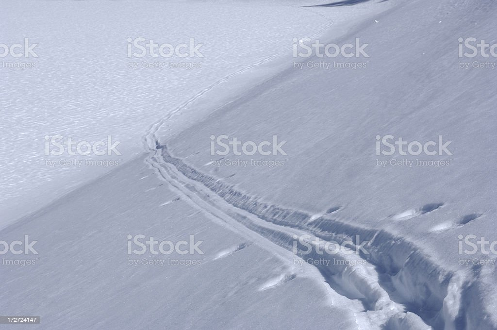 lonely ski tracks can be seen on snow covered hill royalty-free stock photo
