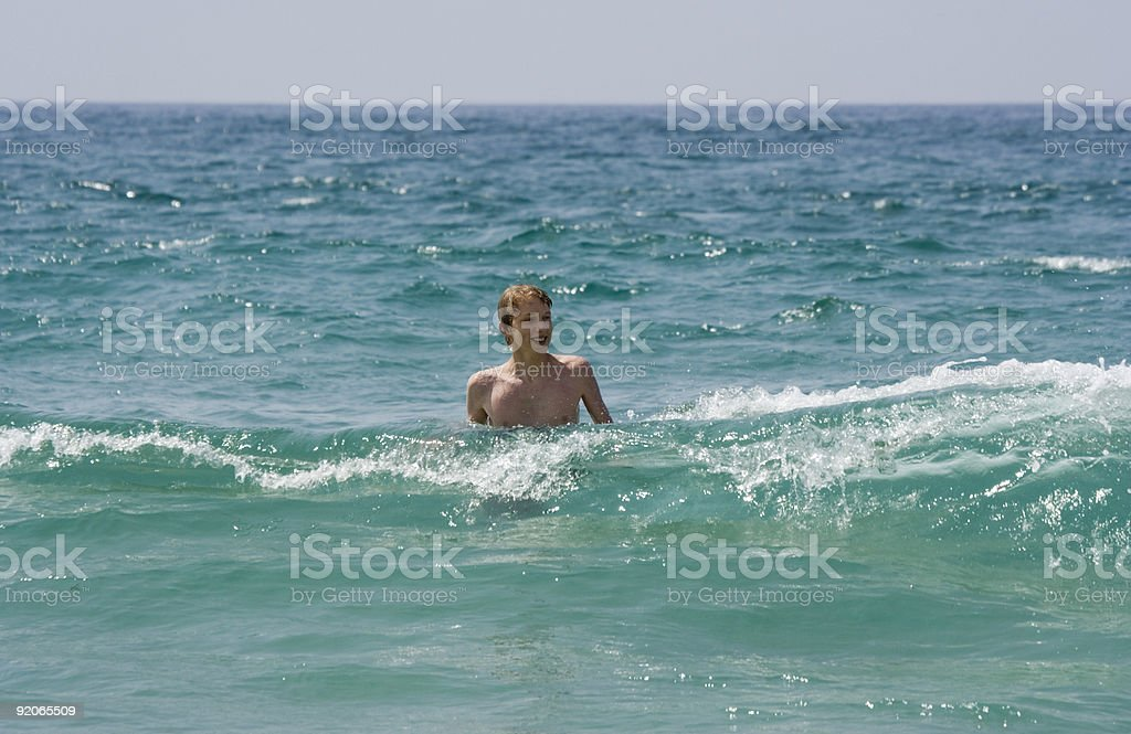 lonely teen in the atlantic ocean royalty-free stock photo