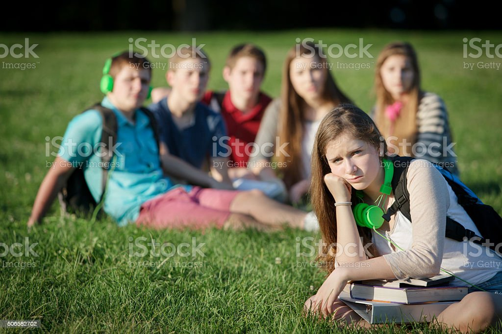 Lonely Teen with Group stock photo