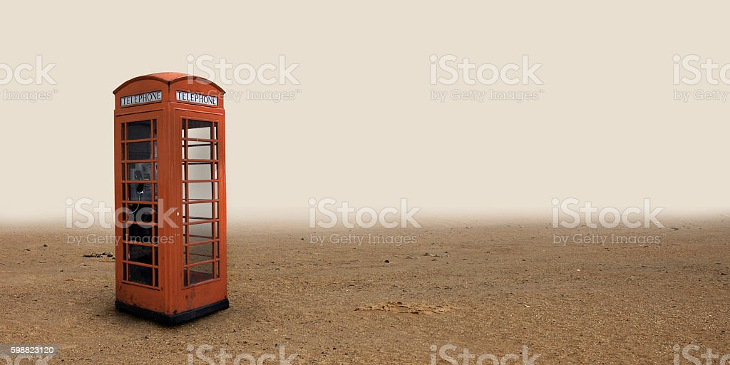Lonely telephone box in the desert. stock photo
