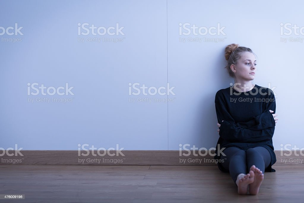 Lonely thoughtful girl stock photo