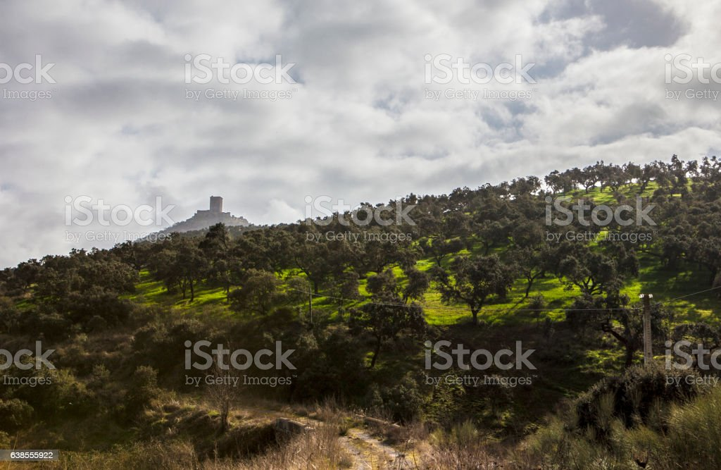 Lonely track road to Feria Castle Hill, Extremadura stock photo